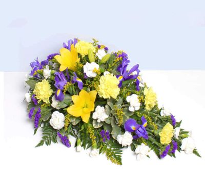 Lily and Iris Spray for giving sincere respect and condolence to the family. Have this arrangement to give farewell to a friend who died.