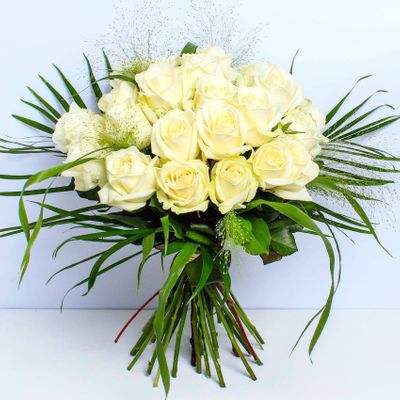 Luxury Two Dozen White Roses are the luxury bouquet that inspires us to be more peaceful and innocent. These 24 white roses have a Compact design with a gold fabric wrap and cello.