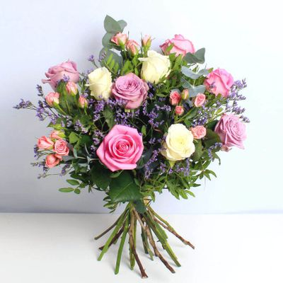 Mixed Roses are blushing flowers that appreciate the blend of colours in a bouquet. These delightful mixed roses that have pink rose, white rose, Lilac Rose, Pink spray Rose, Limonium, Eucalyptus and Pistache.