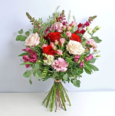Raspberry Red the most beautiful bouquet created to represent peace and love with the most stunning flowers that blend in different colours.