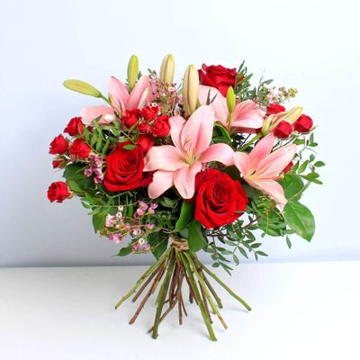 Strawberry flower bouquet surprise your loved ones with a perfect combination of red roses and pink lilies. This elegant display can shiver the heart of your beloved.