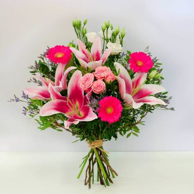 Sweet Memories is a beautiful pink flower bouquet that you can give to someone special. Bring a smile to their face and brighten up their day with this bouquet with pink lilies and roses.