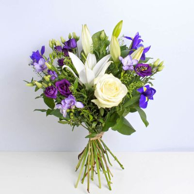 Violet Vibes send good vibes with this stunning arrangement to delight someone's day. A wonderful gift for many occasions.