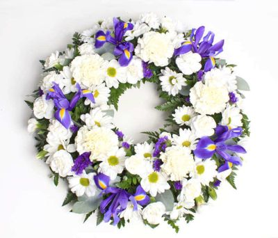 Express your deepest condolence with this lovely blue and White Wreath of life's most pure and peaceful wreath.