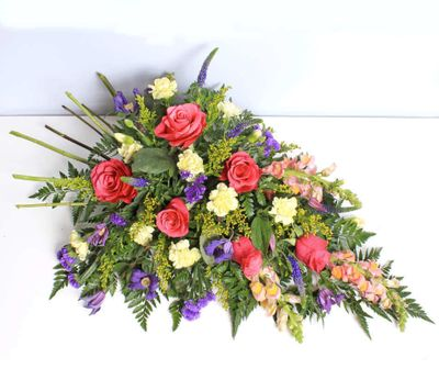 Woodland Spray is when someone comes to the end of the road we can still remind them how much we loved them. With this arrangement, we can give our deepest and sincere condolence to the family.