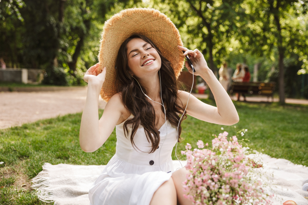 woman with hat having picnic